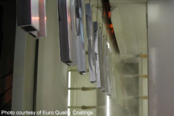 Aluminum extrusions being powder coated by Euro Quality Coatings via Wikimedia Commons