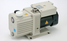 Magnetically coupled oil-sealed rotary vane pumps